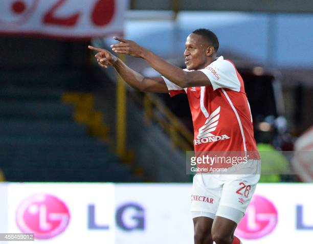 Yerry Mina of Santa Fe celebrates a goal during a match between Millonarios and Independiente Santa Fe as part of Liga Postobon 2014 II at Nemesio...