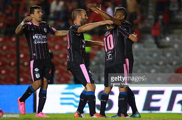 Yerson Candelo of Queretaro celebrates with teammates after scoring the first goal of his team during the 12th round match between Queretaro and...