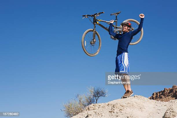 Yes! A mountain biker has made it to the top