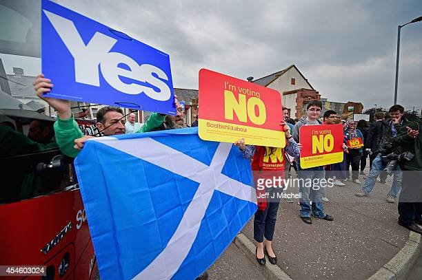 Yes and No campaigners wait for the departure of Labour leader Ed Miliband on the Scottish independence campaign trail on September 4 2014 in...