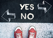 Student standing above the yes and no sign,dilemma concept
