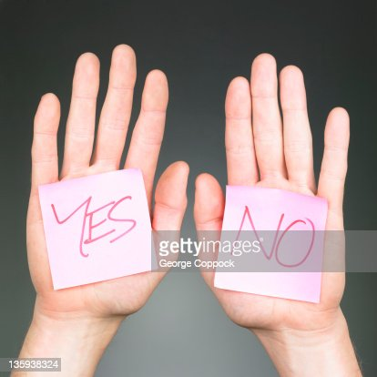 Yes and No on hands : Stock Photo