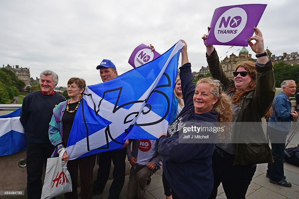 Yes and No supporters gather to listen to <a gi-track='captionPersonalityLinkClicked' href=/galleries/search?phrase=Jim+Murphy+-+Politician&family=editorial&specificpeople=13566433 ng-click='$event.stopPropagation()'>Jim Murphy</a>, Shadow Secretary of State for International Development at a Better Together event at the Mound on September 2, 2014 in Edinburgh,Scotland. Mr Murphy postponed his 100 towns 100 days tour, following being hit by eggs last Friday, claiming that the Yes campaign had organised mobs to intimidate not only him but the undecided voters.
