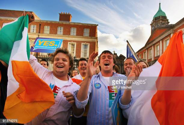 Yes campaigners celebrate the result of the EU Lisbon Treaty outside Dublin Castle on October 3 2009 in Dublin Ireland The people of Ireland have...