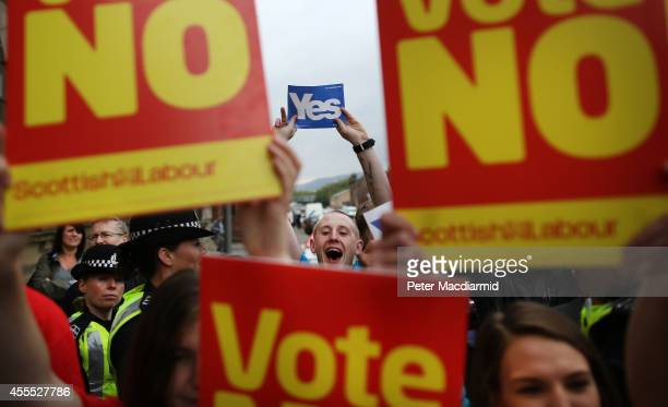 Yes campaigners stand near No supporters at Dumbarton Town Hall as former Prime Minister Gordon Brown leaves after attending a rally on September 16...