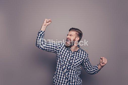 Yes, he did it!  happy bearded man raised hands : Foto de stock