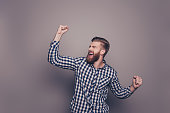 Yes, he did it! portrait of stylish happy bearded man raised hands and shouting