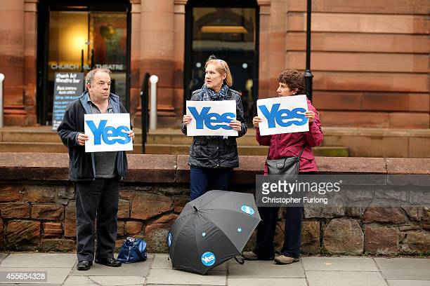 Yes vote campaigners canvass outside Church Hill Theatre polling station during the Scottish referendum on September 18 2014 in Edinburgh Scotland...