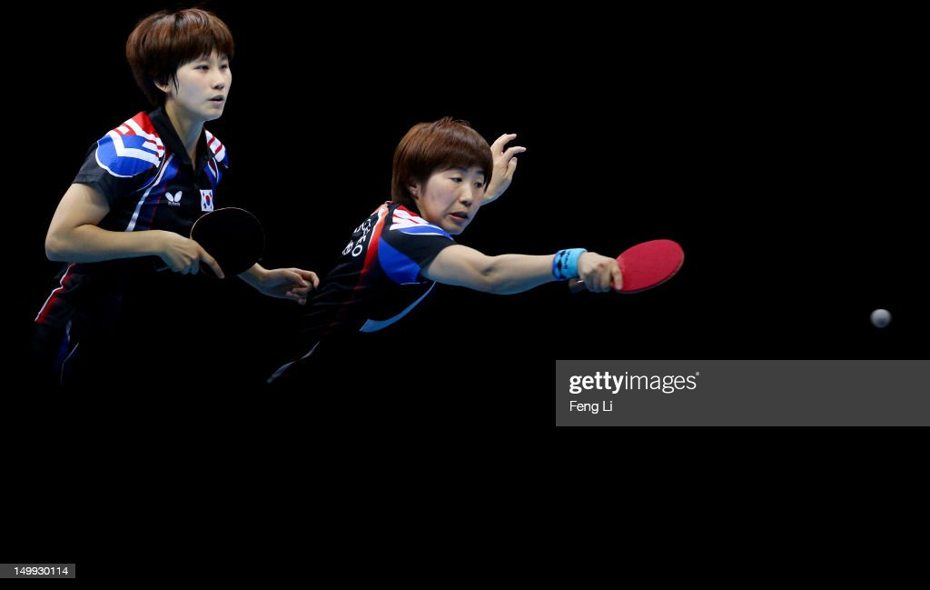 Yeseo Dang and Hajung Seok of Korea compete against Yuegu Wang and Jiawei Li of Singapore during the Women's Team Table Tennis bronze medal match on Day 11 of the London 2012 Olympic Games at ExCeL on August 7, 2012 in London, England.