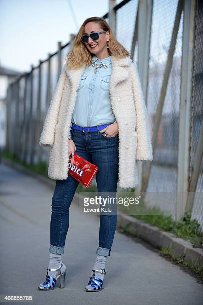 Yesim Ikiz Ozistek poses wearing pants by Massimo Dutti sleeve by Mudo shoes by Colehann fur by Top Shop hand bag by Aldo and sungalasses by Ray Ban...