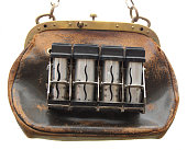 Brown vintage purse or handbag for conductors and other salesmens.