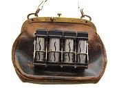 Brown vintage purse or handbag for conductors.