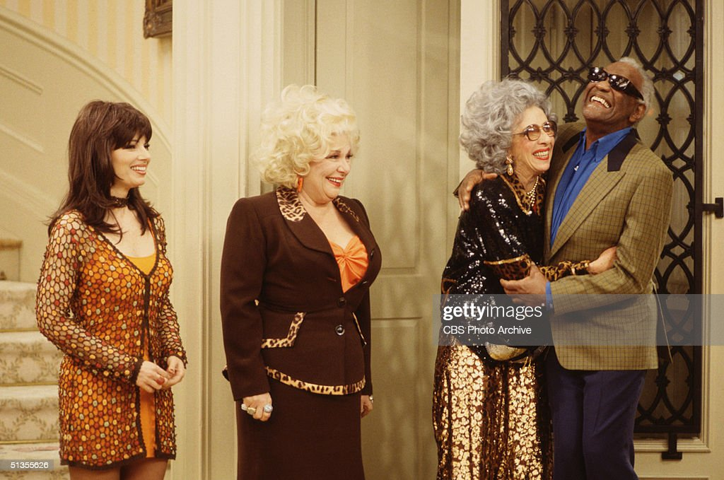 Yetta gives Sammy Portnoy, portrayed by American singer Ray Charles (1930 - 2004), a hug in a scene from 'The Nanny' episode 'Fair Weather Fran,' Los Angeles, California, November 6, 1997. L-R: American actresses Fran Drescher (as Fran Fine), Renee Taylor (as Sylvia Fine), Ann Morgan Guilbert (as Yetta Rosenberg) and Charles.