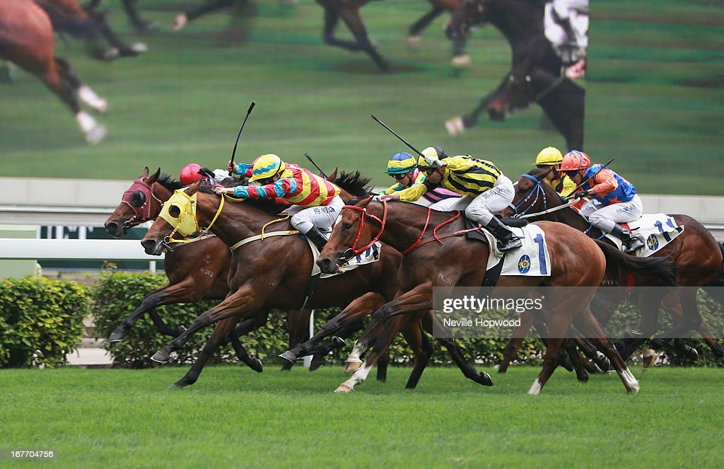 Yeung riding Backstreet Fighter wins the Audemars Piguet Tradition Handicap during the Audemars Piguet Queen Elizabeth II race meeting at Sha Tin racecourse on April 28, 2013 in Hong Kong, Hong Kong.