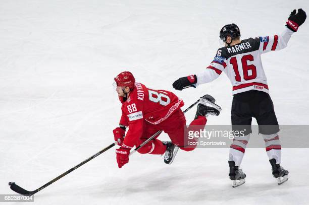 Yevgeni Kovyrshin clashes with Mitchell Marner during the Ice Hockey World Championship between Belarus and Canada at AccorHotels Arena in Paris...