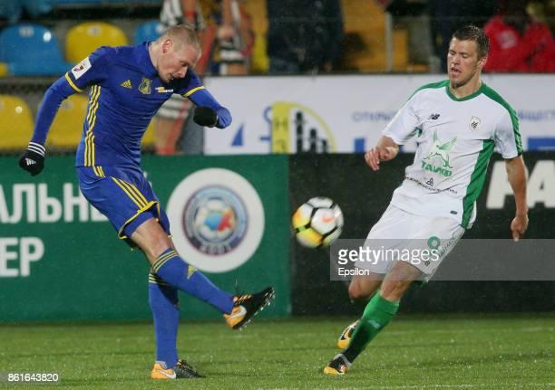 Yevgeni Makeyev of FC Rostov RostovonDon is challenged by Maksim Kanunnikov of FC Rubin Kazan during the Russian Premier League match between FC...