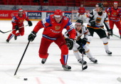 Yevgeni Malkin of Russia and Alex Barta of Germany battle for the puck during the IIHF World Championship group S match between Russia and Germany at...