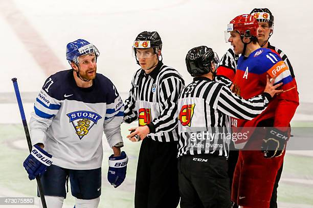 Yevgeni Malkin of Russia argues with Leo Komarov of Finland during the IIHF World Championship group B match between Finland and Russia at CEZ Arena...