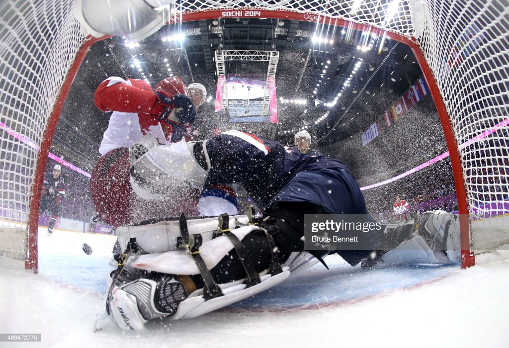 Yevgeni Malkin #11 of Russia attempts to score a goal against <a gi-track='captionPersonalityLinkClicked' href=/galleries/search?phrase=Jonathan+Quick&family=editorial&specificpeople=2271852 ng-click='$event.stopPropagation()'>Jonathan Quick</a> #32 of the United States during the Men's Ice Hockey Preliminary Round Group A game on day eight of the Sochi 2014 Winter Olympics at Bolshoy Ice Dome on February 15, 2014 in Sochi, Russia.
