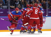 Yevgeni Malkin of Russia celebrates with teammates after scoring a goal in the first period against Slovenia during the Men's Ice Hockey Preliminary...