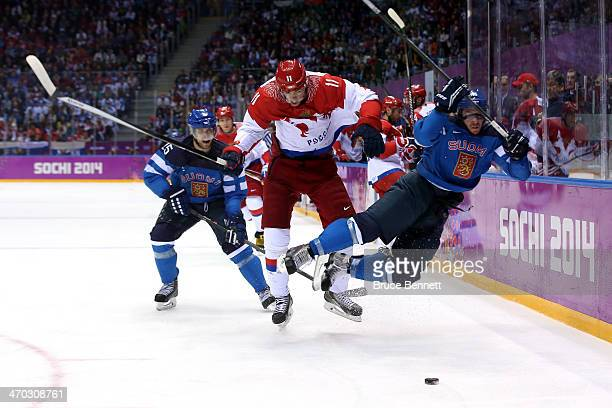 Yevgeni Malkin of Russia knocks Sami Vatanen of Finland into the boards during the Men's Ice Hockey Quarterfinal Playoff on Day 12 of the 2014 Sochi...