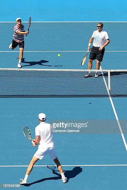 Yevgeny Kafelnikov of Russia and Wayne Ferreira of Russia in their Legends doubles match against Guy Forget and Henri Leconte of France during day...