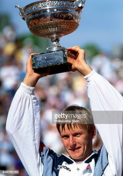 Yevgeny Kafelnikov of Russia holds the trophy aloft after winning the men's singles final during the French Open Tennis Championships at the Roland...