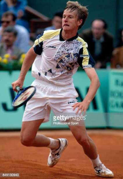 Yevgeny Kafelnikov of Russia in action during a men's singles match at the French Open Tennis Championships at the Roland Garros Stadium in Paris...