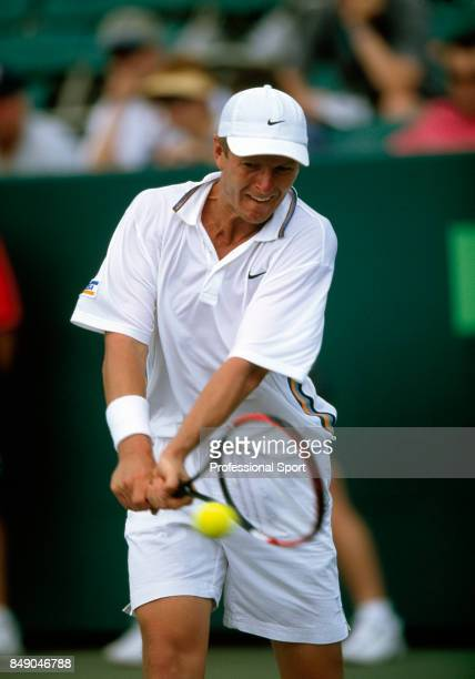 Yevgeny Kafelnikov of Russia in action during the NASDAQ100 Open Tennis Champonships in Key Biscayne Florida circa March 2002 Kafelnikov lost in...
