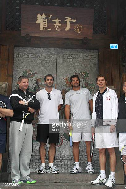 Yevgeny Kafelnikov of Russia Pete Sampras of United States Pat Rafter of Australia and Thomas Enqvist of Sweden pose for a photo during visit the...