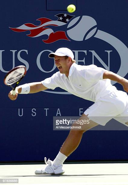 Yevgeny Kafelnikov of Russia stretches for a forehand Sunday August 31 2003 at the U S Open in New York Kafelnikov lost in straight sets to Andre...