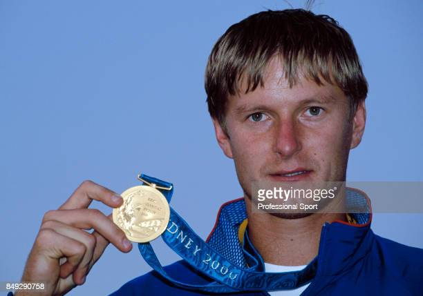Yevgeny Kafelnikov of Russia with the gold medal for the men's singles tennis championship during the Summer Olympic Games in Sydney Australia circa...
