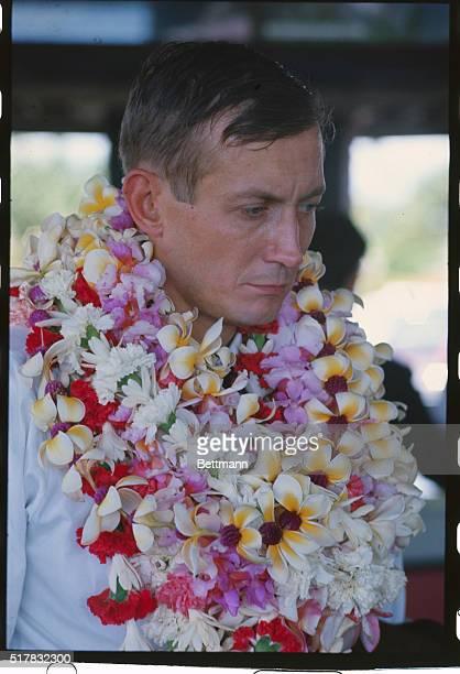 12/1968 Yevgeny Yevtushenko Russian poet with flowers around his neck Place unknown