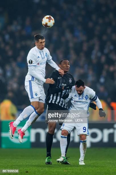 Yevhen Khacheridi and Mykola Morozyuk of FC Dynamo Kyiv competes with Leandre Tawamba of FK Partizan Belgrade during the UEFA Europa League group B...