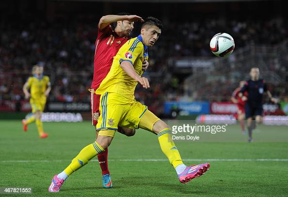 Yevhen Khacheridi of Ukraine shields the ball from Pedro Rodriguez of Spain during the Spain v Ukraine EURO 2016 Qualifier at Estadio Ramon Sanchez...