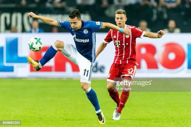 Yevhen Konoplyanka of FC Schalke 04 Joshua Kimmich of FC Bayern Munich during the Bundesliga match between Schalke 04 and Bayern Munich on September...