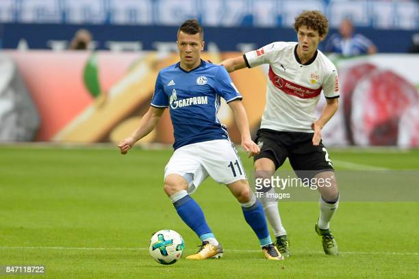 Yevhen Konoplyanka of Schalke and Benjamin Pavard of Stuttgart battle for the ball during the Bundesliga match between FC Schalke 04 and VfB...