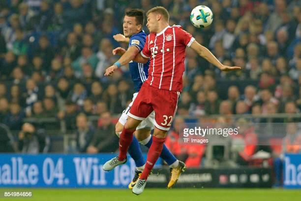 Yevhen Konoplyanka of Schalke and Joshua Kimmich of Muenchen battle for the ball during the Bundesliga match between FC Schalke 04 and FC Bayern...