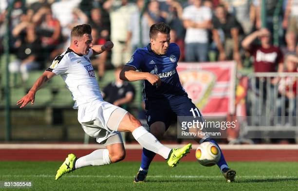 Yevhen Konoplyanka of Schalke and Marcel Rausch of Berlin vie during the DFB Cup first round match between BFC Dynamo and FC Schalke 04 at...