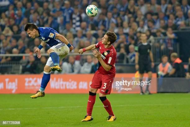 Yevhen Konoplyanka of Schalke and Panagiotis Retsos of Leverkusen battle for the ball during the Bundesliga match between FC Schalke 04 and Bayer 04...