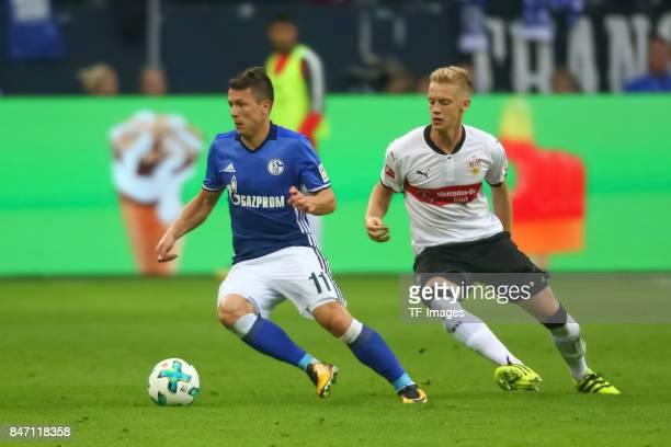 Yevhen Konoplyanka of Schalke and Timo Baumgartl of Stuttgart battle for the ball during the Bundesliga match between FC Schalke 04 and VfB Stuttgart...