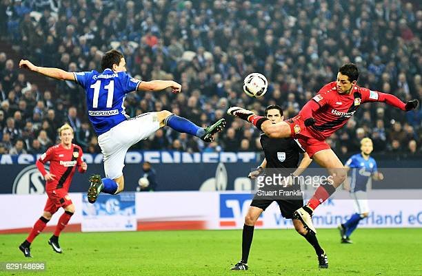 Yevhen Konoplyanka of Schalke battles for the ball with Chicharito of Leverkusen during the Bundesliga match between FC Schalke 04 and Bayer 04...