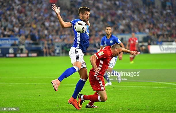 Yevhen Konoplyanka of Schalke fouls Franck Ribrry of Bayern Muenchen during the Bundesliga match between FC Schalke 04 and Bayern Muenchen at...