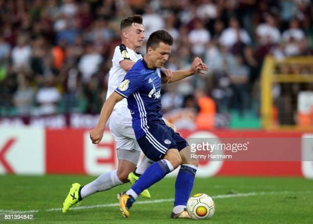 Yevhen Konoplyanka of Schalke scores his team's second goal next to Marcel Rausch of Berlin during the DFB Cup first round match between BFC Dynamo...