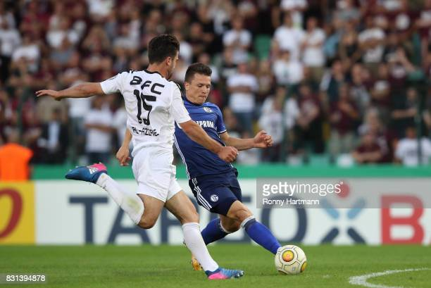 Yevhen Konoplyanka of Schalke vies with David Kamm AlAzzawe of Berlin during the DFB Cup first round match between BFC Dynamo and FC Schalke 04 at...