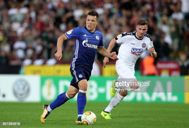 Yevhen Konoplyanka of Schalke vies with Marcel Rausch of Berlin during the DFB Cup first round match between BFC Dynamo and FC Schalke 04 at...