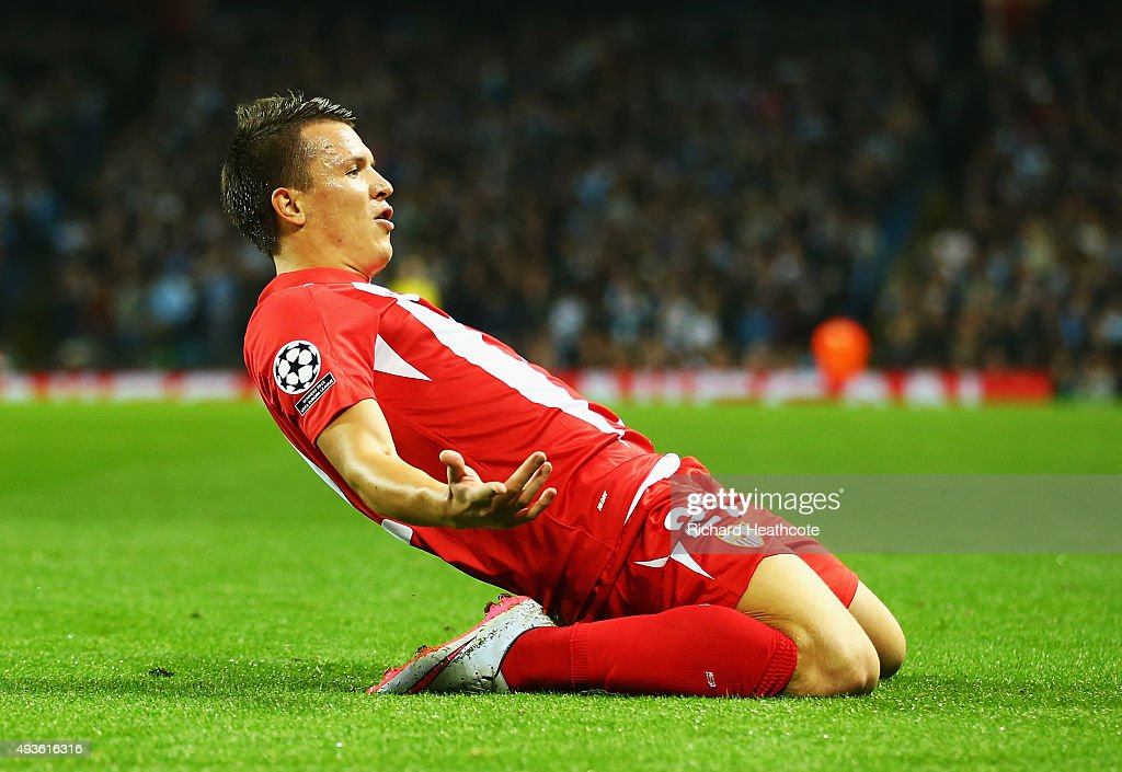 Yevhen Konoplyanka of Sevilla celebrates scoring the opening goal during the UEFA Champions League Group D match between Manchester City and Sevilla...