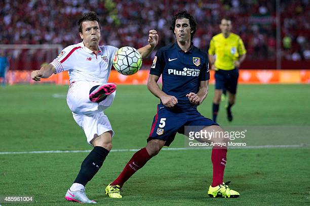 Yevhen Konoplyanka of Sevilla FC competes for the ball with Tiago Mendes of Atletico de Madrid during the La Liga match between Sevilla FC and Club...