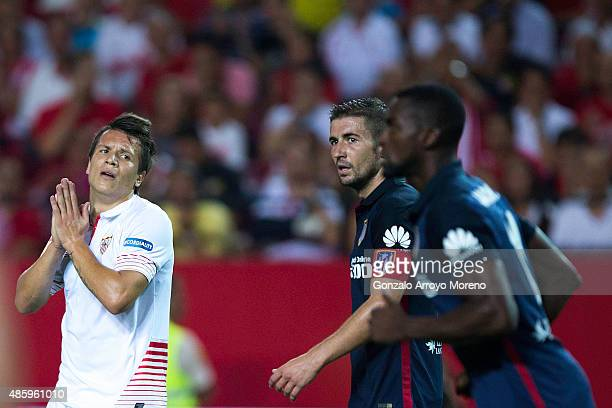 Yevhen Konoplyanka of Sevilla FC reacts as he fail to score close to Gabi Fernandez of Atletico de Madrid and his teammate Jackson Arley Martinez...