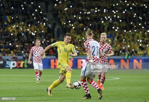 Yevhen Konoplyanka of Ukraine battles for the ball against Domagoj Vida and Ivan Rakitic of Croatia during the FIFA 2018 World Cup Group I Qualifier...